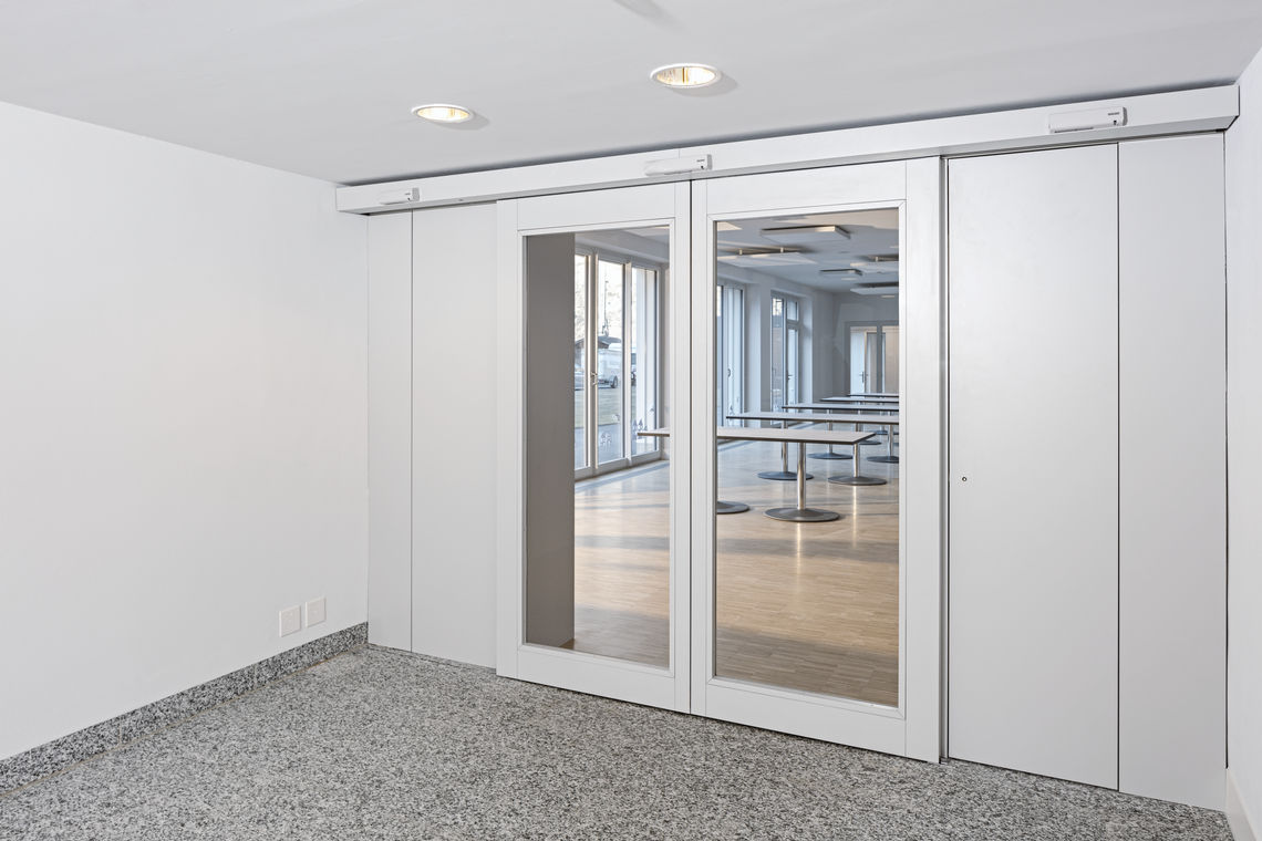 GEZE Slimdrive, the automatic linear sliding door system for escape and rescue routes, in the new extension to the Fux Campagna residential home.