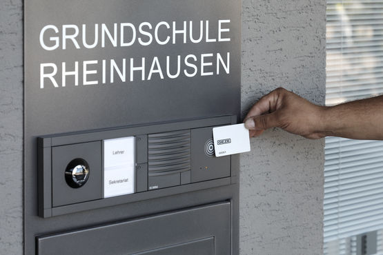 MIFARE RFID cards are held against the GEZE INAC reader at the entrance to Rheinhausen primary school
