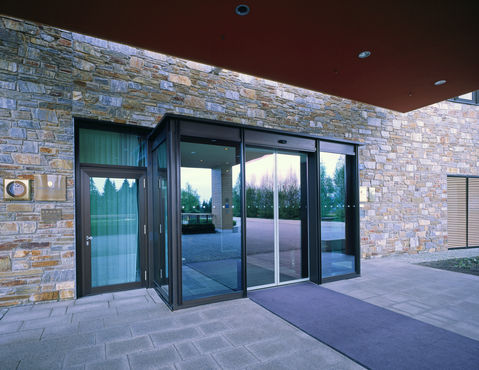 Glazed automatic door in the hotel entrance.