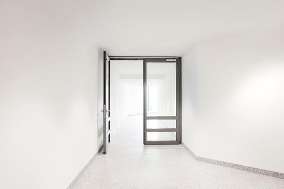 Glazed double-leaf door in clinic inner area