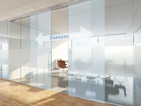 The Perlan 140 Duosync roller sliding fitting opens and closes double leaf sliding doors synchronously.