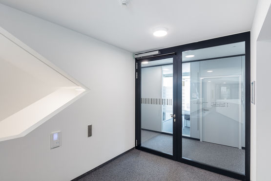 Fire protection doors secure openings in fire sections.