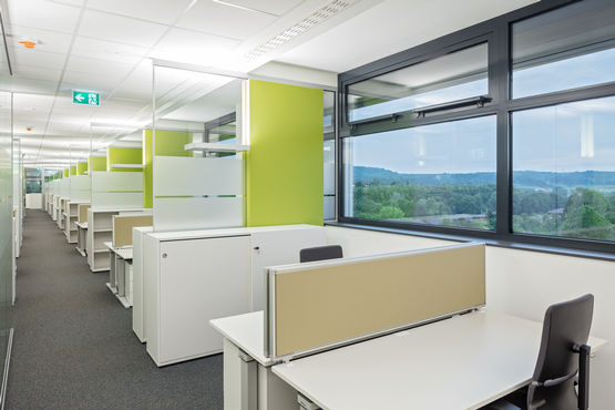 Open-plan offices provide flexible work spaces and short communication channels.