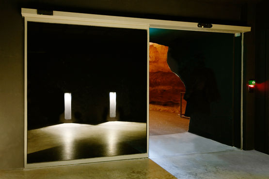 Entry to the replica caves with automatic Slimdrive SL NT sliding door system. Photo: Jean-Luc Kokel for GEZE GmbH
