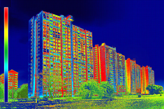 Thermal imaging tells experts everything about heat and energy losses from a façade. Dark areas show little loss, yellow indicates some loss, and red areas mean serious heat losses.