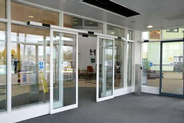 Glazed sliding door systems at the entrance to the children's clinic.