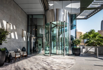 Especially high revolving door systems with heavy leaves. Special drive technology for revolving doors from GEZE ensures high door comfort.