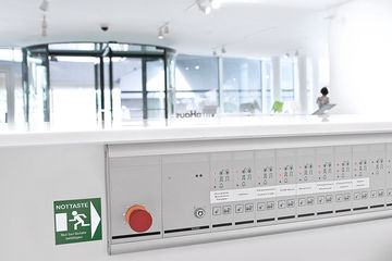 Serves to centrally monitor and control individual emergency exits or groups. Wall panel with key-operated button to lock and protect against unauthorised access.  Display of alarm or door state.  Central display and control of GEZE systems and third-party products.  Manipulation or unauthorised opening of doors can be identified immediately and followed up.