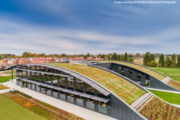 This environmentally building even includes a living roof to attract birds and insects.